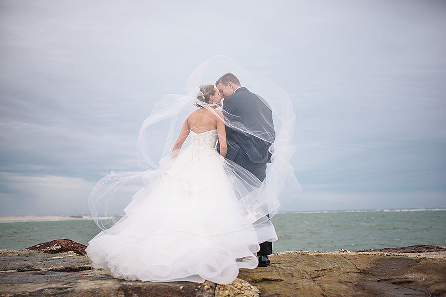 Photo of Jersey Shore newly wed bride and groom on the beach by Jersey Shore Wedding Photographer Meghan Burke