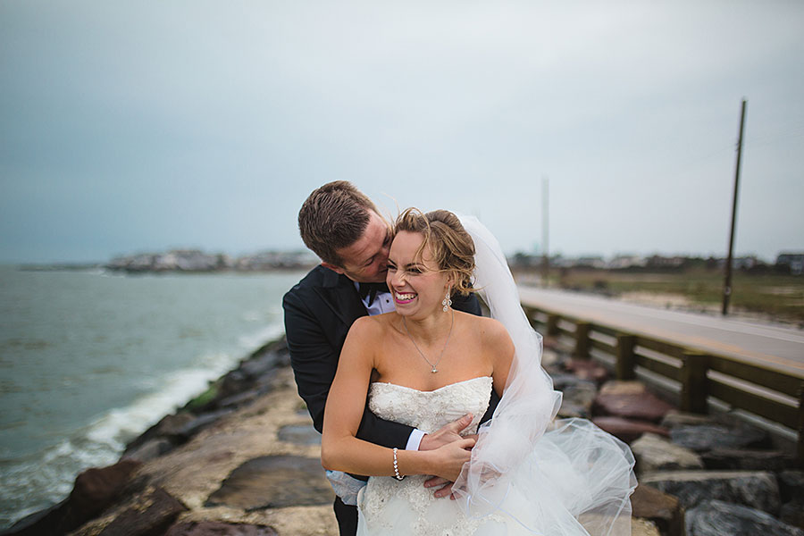 Laughing bride and groom wedding portrait on the Jersey Shore by Jersey Shore Wedding Photographer Meghan Burke