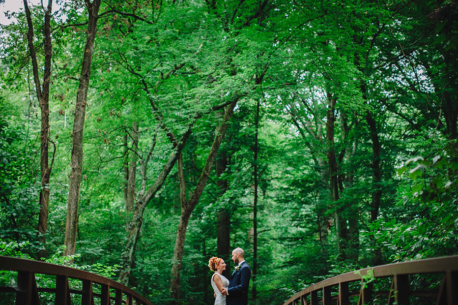 Bride and groom on a bridge in Philadelphia by Philadelphia Wedding Photographer Meghan Burke