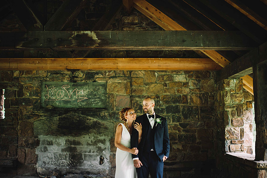Philadelphia newlywed couple photographed inside stone building in Philadelphia by Philadelphia Wedding Photographer Meghan Burke